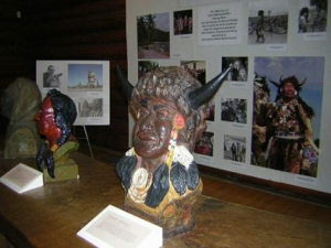 a bust of Walking Buffalo with his photo behind